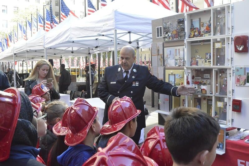 Lt. Frank Minetta with the FDNY Fire Safety Education Unit teaching new friends how to be #FDNYSmart.